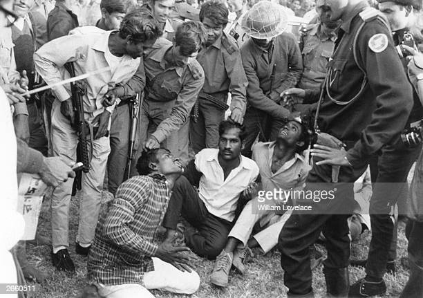 Indian Mukti Bahini guerilla troops preparing to bayonet men who collaborated with the Pakistani Army during East Pakistan's fight to become the...