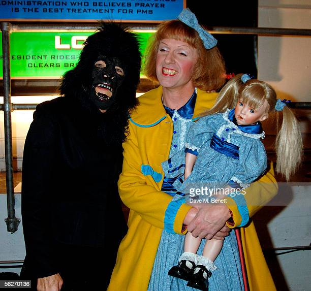 Guerrilla girl and Grayson Perry attend the Private View for the new Amnesty International exhibition 'Imagine A World' at The Bargehouse on November...
