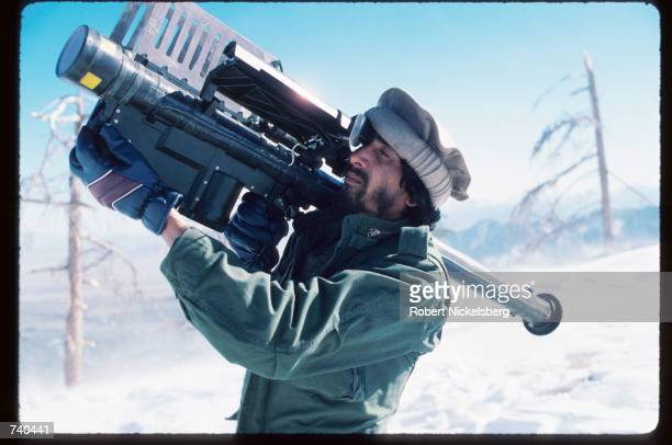 A guerrilla soldier aims a stinger missle at passing aircraft near a remote rebel base in the Safed Koh Mountains February 10 1988 in Afghanistan A...