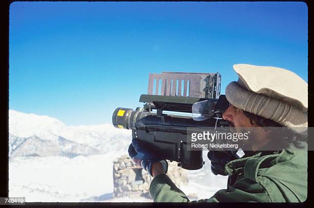 A guerrilla soldier aims a stinger missle towards enemy aircraft near a remote rebel base in the Safed Koh Mountains February 10 1988 in Afghanistan...