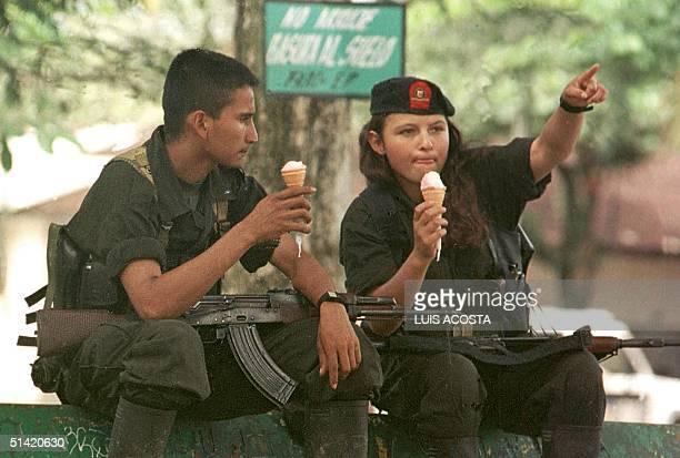Guerrillas of the Revolutionary Armed Forces of Colombia eat icecream in San Vicente Caguan 710 km from Bogota 29 June 2000 Guerrilleros de las FARC...