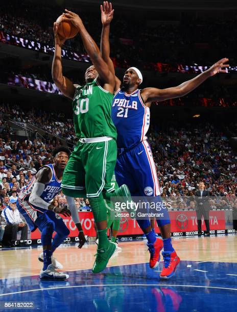 Guerschon Yabusele of the Boston Celtics shoots the ball against Joel Embiid of the Philadelphia 76ers during the game on October 20 2017 at Wells...