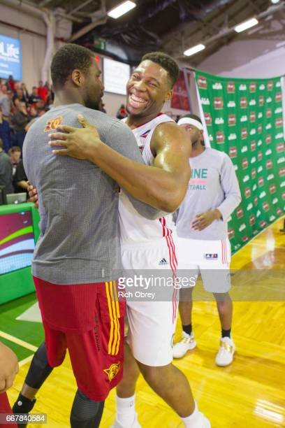 Guerschon Yabusele of the Maine Red Claws smiles in the handshake line after the playoff game victory against the Ft Wayne Mad Ants in Game 3 of...