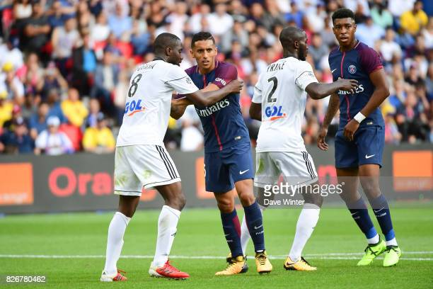 Guessouma Fofana of Amiens Marquinhos of PSG Prince Desir Gouano of Amiens and Kimpembe Presnel of PSG jostle for position at a corner during the...