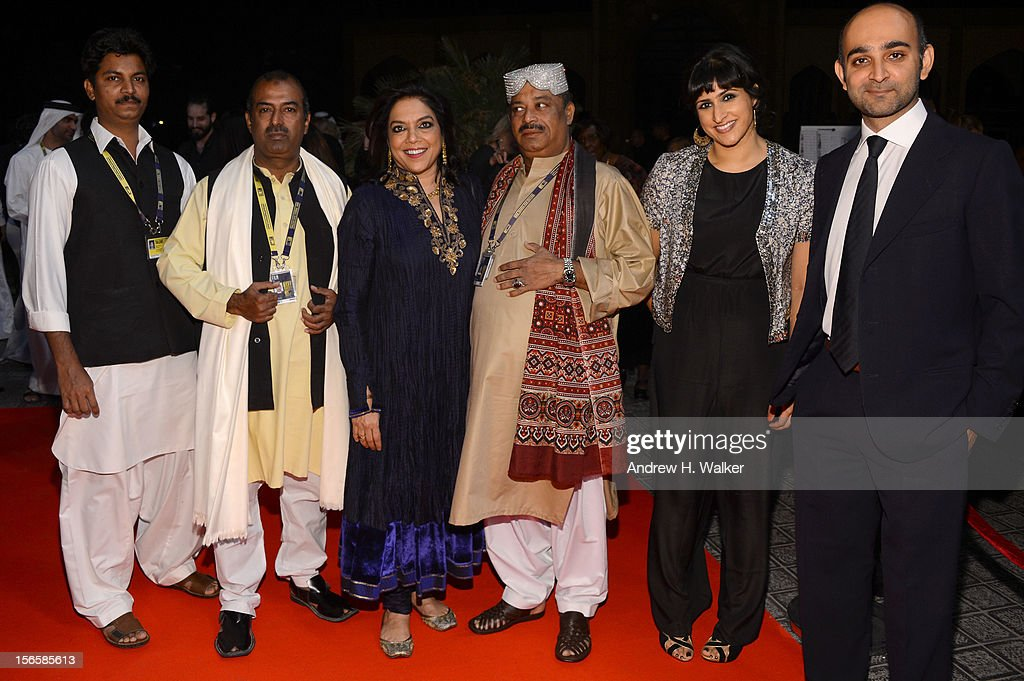 Guest, Abu Muhammad, director <a gi-track='captionPersonalityLinkClicked' href=/galleries/search?phrase=Mira+Nair&family=editorial&specificpeople=214181 ng-click='$event.stopPropagation()'>Mira Nair</a>, Fariduddin Ayaz, screenwriter Ami Boghani and novellist Mohsin Hamid attend the opening night ceremony and gala screening of 'The Reluctant Fundamentalist' during the 2012 Doha Tribeca Film Festival at Al Mirqab Hotel on November 17, 2012 in Doha, Qatar.