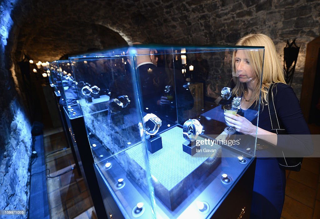 A guest admires the watches at the Excalibur Dinner hosted by Roger Dubuis during the 23rd Salon International de la Haute Horlogerie at Caves des Vollandes on January 23, 2013 in Geneva, Switzerland.