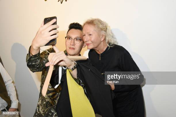 A guest and Agnes B pose for a selfie during Agnes B Menswear Spring/Summer 2018 show as part of Paris Fashion Week ton June 25 2017 in Paris France