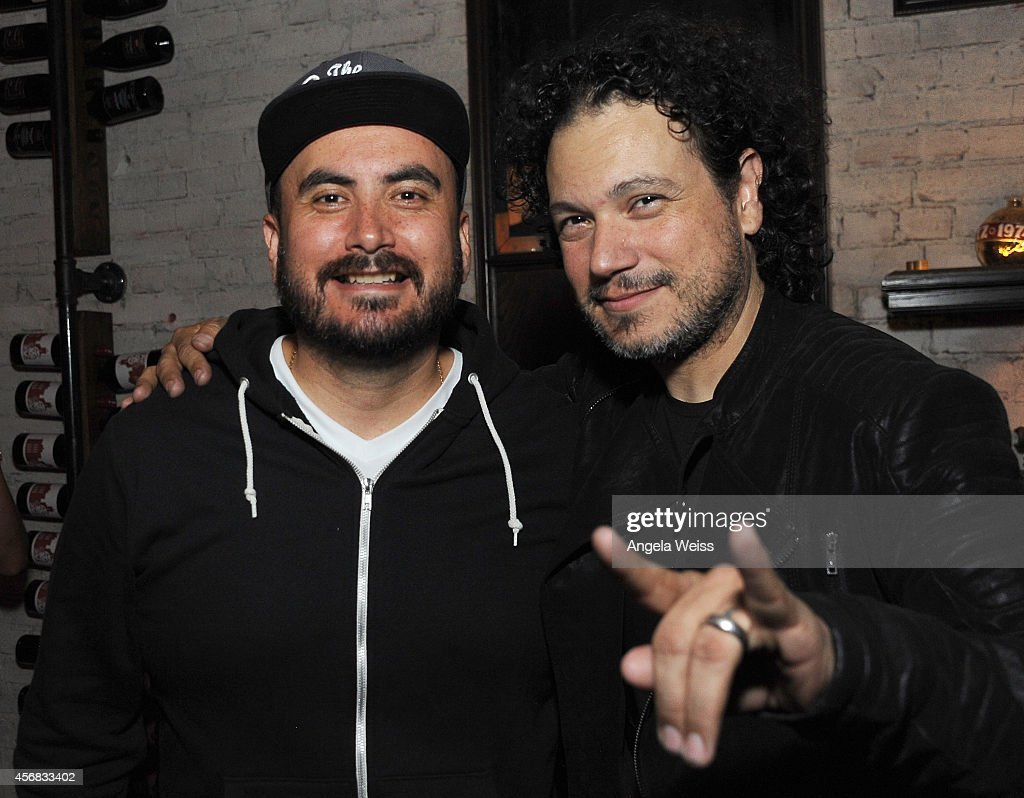 Guest and Asdru Sierra of ABSTRAKTO attend the Balthazar Getty and Spotify present a Night with PurpleHaus Music event on October 7 2014 in Los...
