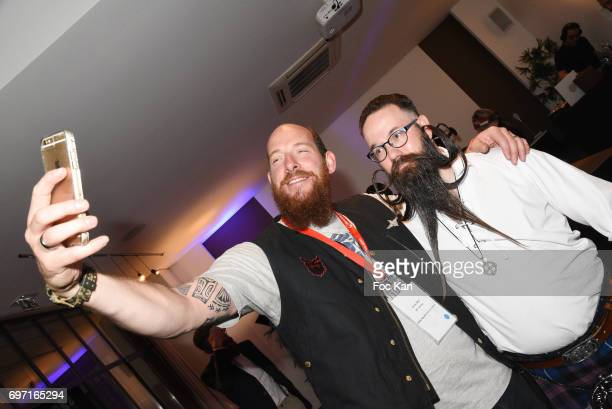 A guest and Audacious beard winner Richard Palatchi attend ÊFrance Beard Championship 2017 Hosted by Beardilizer at Cite de la Roquette on June17...