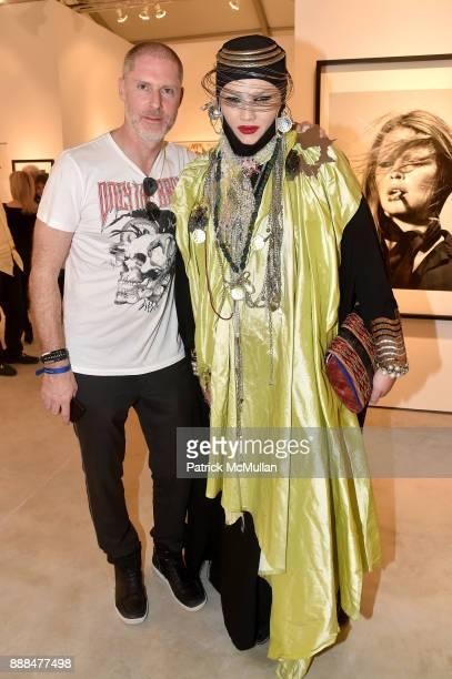 Guest and Daniel Lismore attend Art Miami VIP Preview at Art Miami Pavilion on December 6 2017 in Miami Beach Florida
