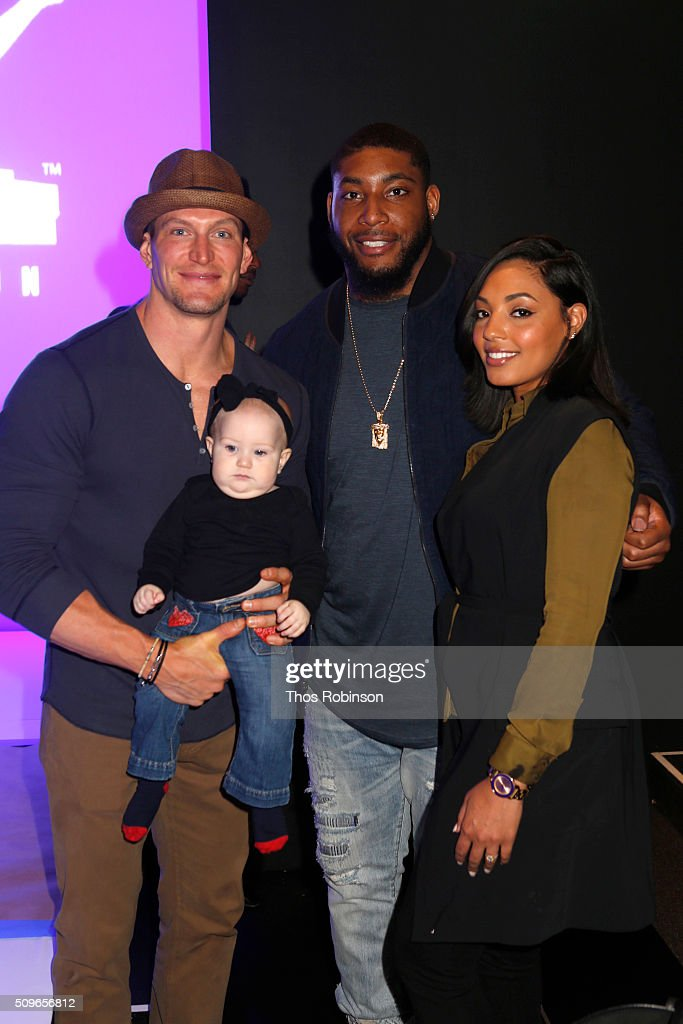 Guest and <a gi-track='captionPersonalityLinkClicked' href=/galleries/search?phrase=Devon+Still&family=editorial&specificpeople=6400915 ng-click='$event.stopPropagation()'>Devon Still</a> and his wife attend Nike/Levi's Kids Rock! Runway Show on February 11, 2016 in New York City.