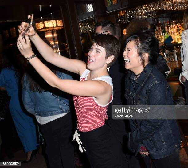 A guest and Kelly Marie Tran attend The ELLE Super Bowl Presented by AG on October 13 2017 in Los Angeles California