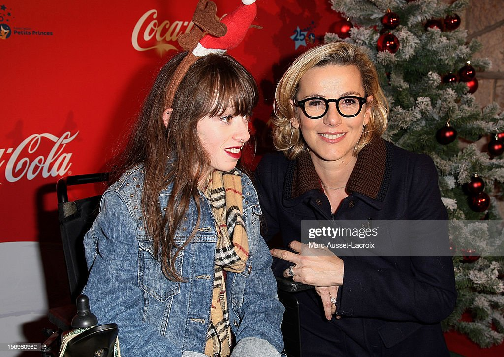 Guest and Laurence Ferrari poses at the Coca Cola Christmas windows inauguration at Le Showcase on November 26, 2012 in Paris, France.