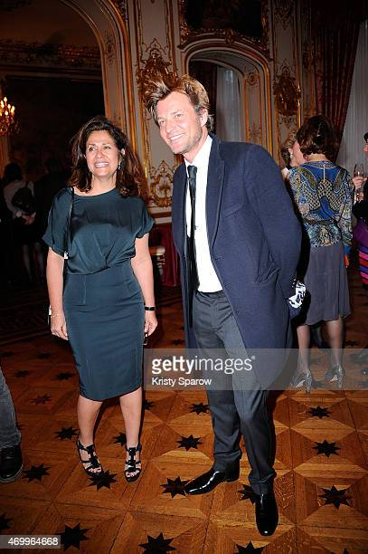 A guest and Laurent Delahousse attend the 'Autistes Sans Frontiere' Charity Gala at Artcurial Dassault on April 16 2015 in Paris France