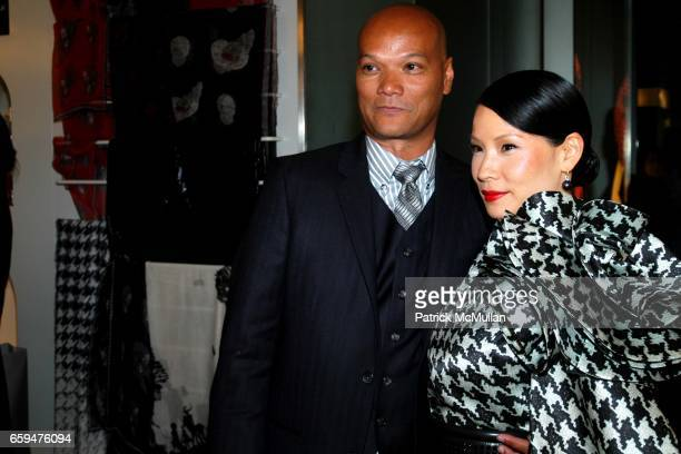 Guest and Lucy Liu attend ALEXANDER MCQUEEN Fashion's Night Out at Alexander McQueen Store on September 10 2009 in New York