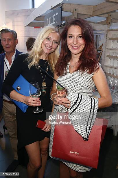 A guest and Mara Bermann attend the Thomas Rath show during Platform Fashion July 2016 at Areal Boehler on July 24 2016 in Duesseldorf Germany
