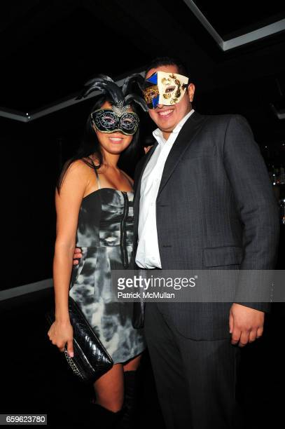 Guest and Odin Erickson attend INTERVIEW Russian Masquerade with Alex Ani and Stolichnaya Vodka at SL on October 22 2009 in New York City