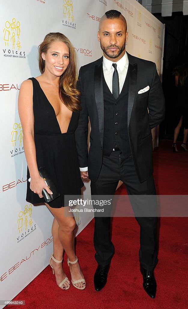 Guest (L) and Ricky Whittle arrive at 'The Beauty Book For Brain Cancer' Edition Two Launch Party sponsored by Voices Against Brain Cancer on December 3, 2015 in Los Angeles, California.