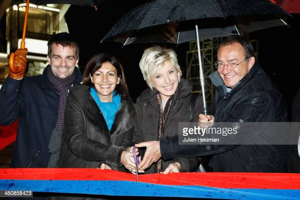 Guest Anne Hidalgo Evelyne Dheliat and Jean Pierre Pernaut attend the launch of the Paris Christmas illuminations on November 20 2013 in Paris France