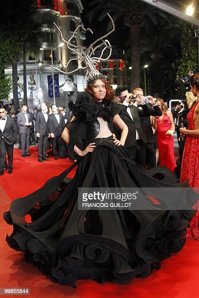 A guest arrives for the screening of 'Outrage' presented in competition at the 63rd Cannes Film Festival on May 17 2010 in Cannes AFP PHOTO /...
