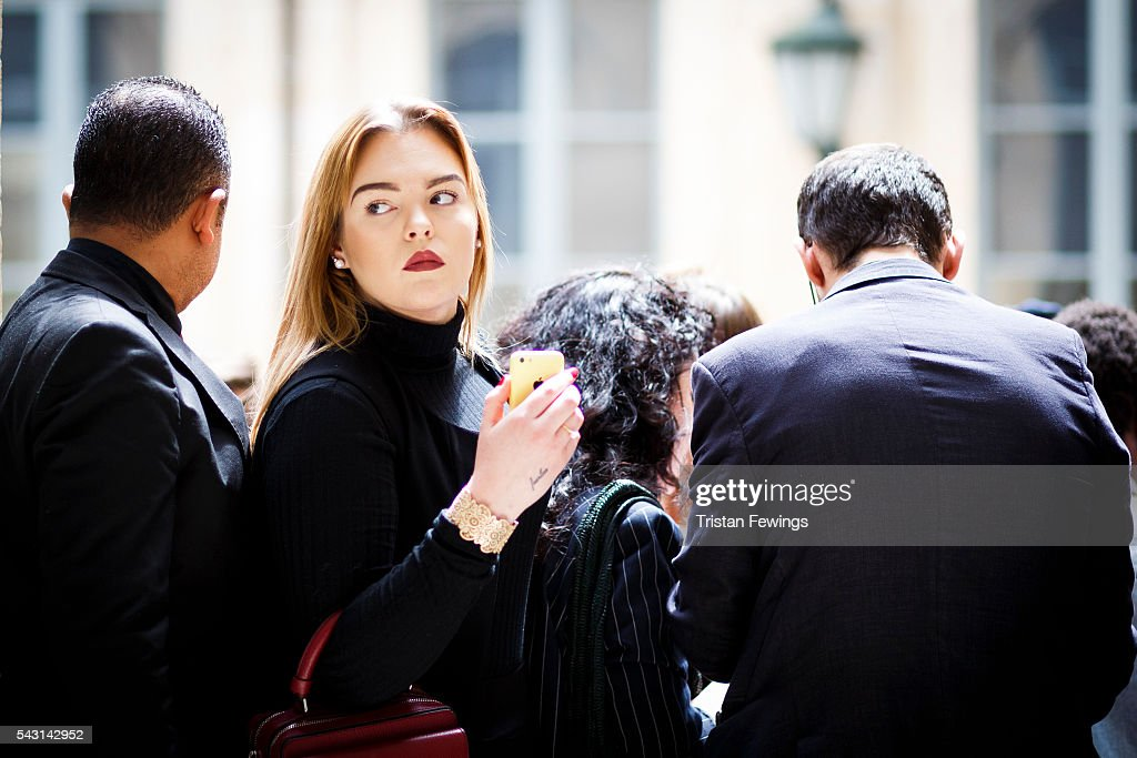 A guest arrives for the Sean Suen Menswear Spring/Summer 2017 show as part of Paris Fashion Week on June 26, 2016 in Paris, France.
