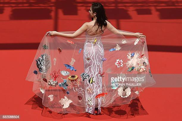 TOPSHOT A guest arrives on May 18 2016 for the screening of the film 'Ma'Rosa' at the 69th Cannes Film Festival in Cannes southern France / AFP /...