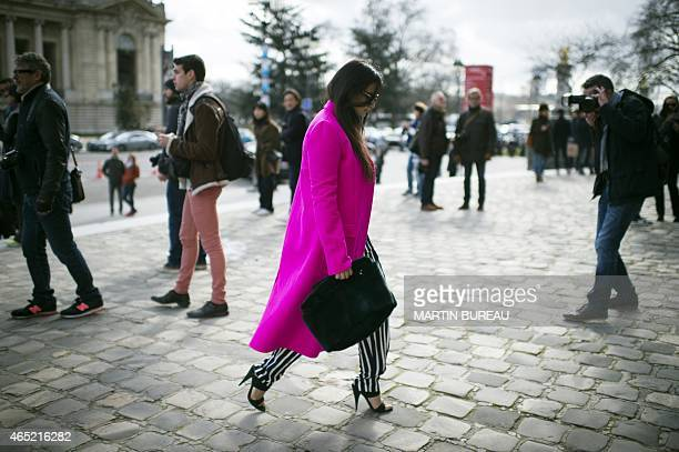 A guest arrives to attend Guy Laroche 20152016 Fall/Winter readytowear collection fashion show on March 4 2015 in Paris AFP PHOTO / MARTIN BUREAU