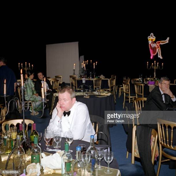 A guest at the Systems Union Las Vegasthemed party rests his eyes after dinner in a marquee in Farnborough November 2002