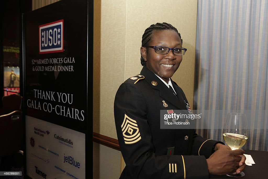 Guest attends 52nd USO Armed Forces Gala & Gold Medal Dinner at Marriott Marquis Times Square on December 11, 2013 in New York City.
