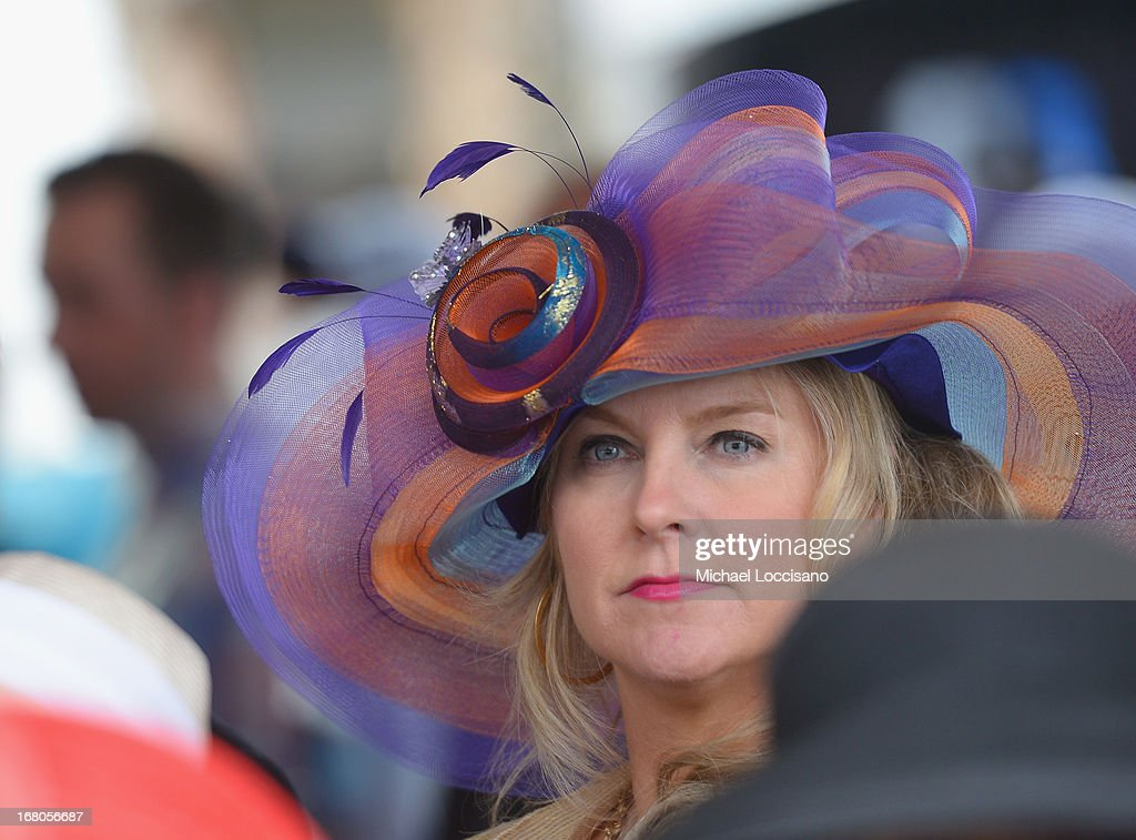 A guest attends the 139th Kentucky Derby at Churchill Downs on May 4, 2013 in Louisville, Kentucky.