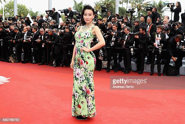 A guest attends the 'Cafe Society' premiere and the Opening Night Gala during the 69th annual Cannes Film Festival at the Palais des Festivals on May...