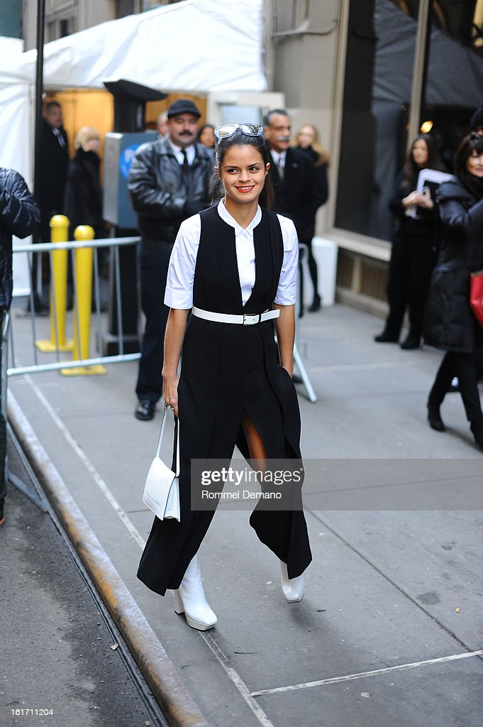 A guest attends the Calvin Klein show wearing a Calvin Klein dress on February 14, 2013 in New York City.