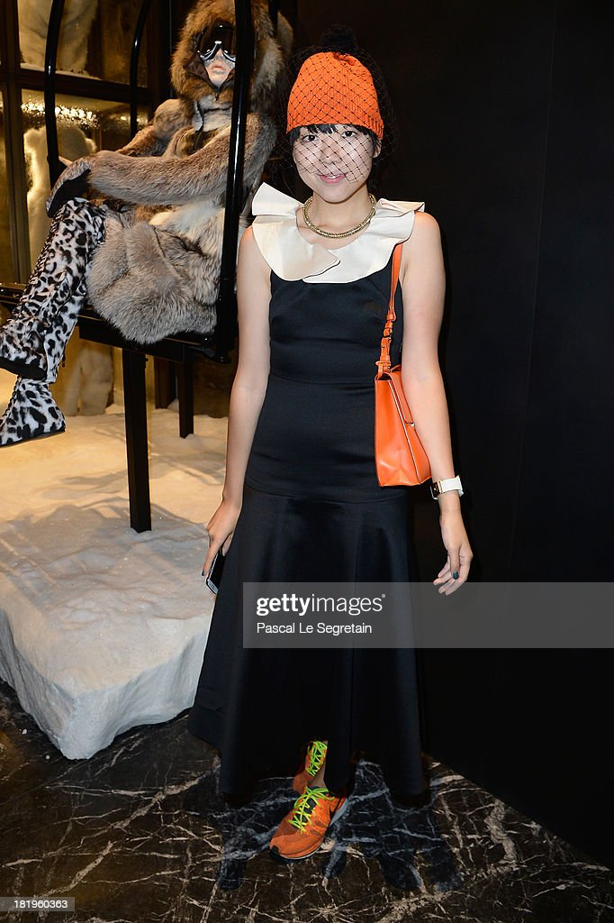 Guest attends the cocktail for the Moncler New Flagship Opening in Paris at Rue Du Faubourg Saint-Honore on September 26, 2013 in Paris, France.