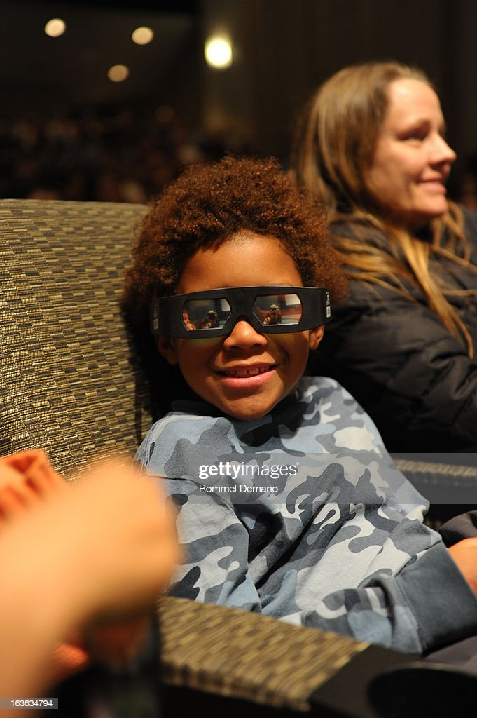 A guest attends 'The Croods' screening at The Film Society of Lincoln Center, Walter Reade Theatre on March 13, 2013 in New York City.