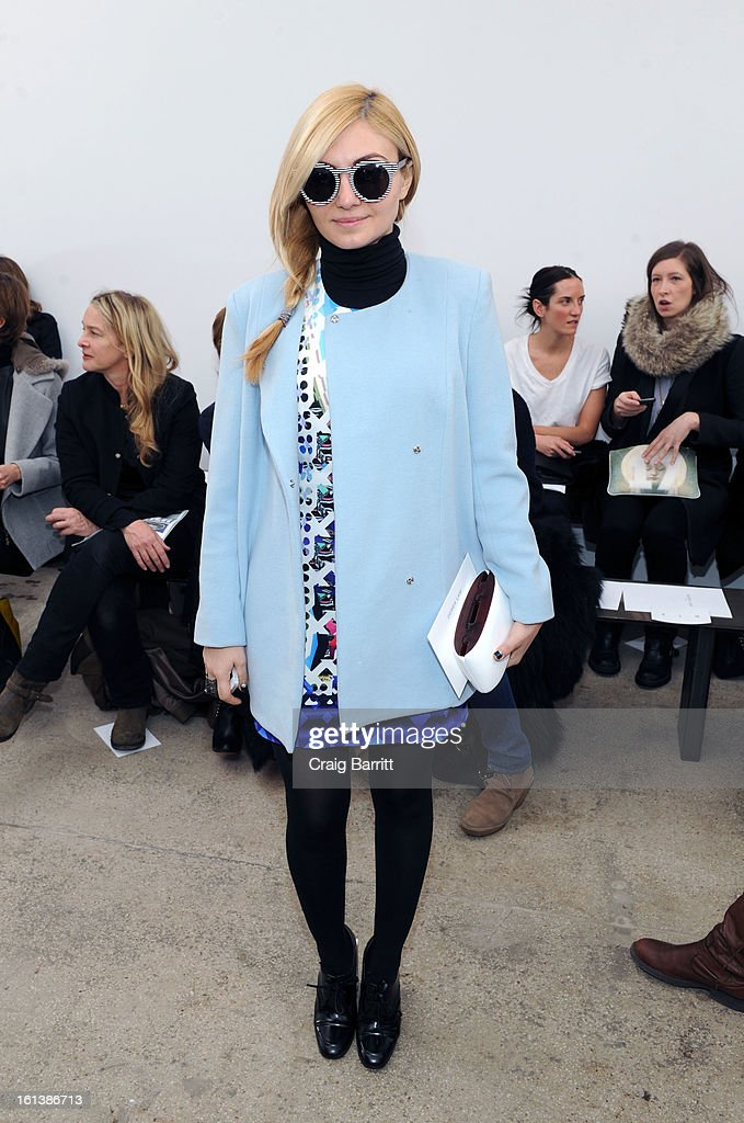 A guest attends the Derek Lam fall 2013 fashion show during Mercedes-Benz Fashion Week at Sean Kelly Gallery on February 10, 2013 in New York City.