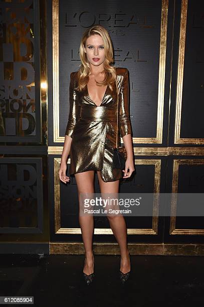 Guest attends the Gold Obsession Party L'Oreal Paris Photocall as part of the Paris Fashion Week Womenswear Spring/Summer 2017 on October 2 2016 in...