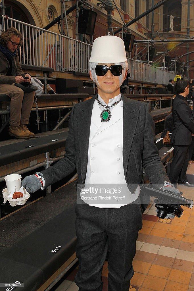 A guest attends the Lanvin Men Autumn / Winter 2013 show at Ecole Nationale Superieure Des Beaux-Arts as part of Paris Fashion Week on January 20, 2013 in Paris, France.