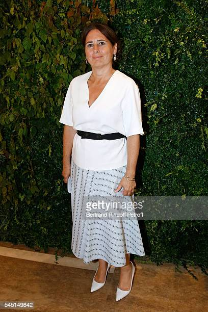 A guest attends the Re Opening of Salvatore Ferragamo Boutique at Avenue Montaigne on July 5 2016 in Paris France
