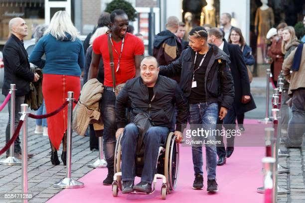 Guest Berni Goldblat and Makan Nathan Diarra arrive at Namur Theater for the Award Ceremony of 32nd Namur International FrenchLanguage Film Festival...