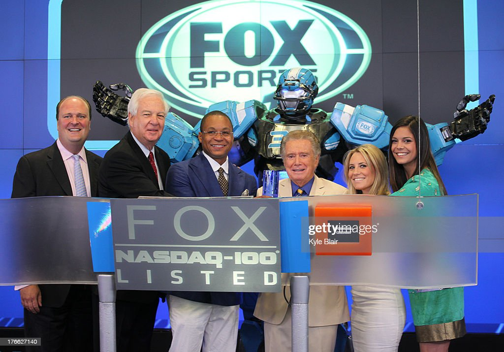 Guest; Bill Raftery; Gus Johnson; Cleatus The Robot; <a gi-track='captionPersonalityLinkClicked' href=/galleries/search?phrase=Regis+Philbin&family=editorial&specificpeople=202495 ng-click='$event.stopPropagation()'>Regis Philbin</a>; Fox Sports Girls ring the opening bell at the NASDAQ MarketSite on August 16, 2013 in New York City.