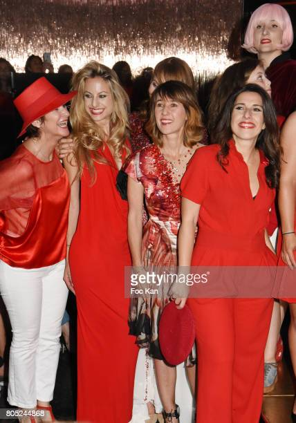 Guest Candice de Saint Pern Alexia Laroche Joubert Nathalie Levy and Ornette attend the 'Red Defile' Auction Fashion Show Hosted by Ajila Association...