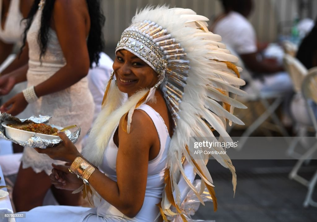 Guest Cara Fort attends the annual New York City Diner en Blanc, August 22, 2017 held this year at the plaza at Lincoln Center. The Diner en Blanc, the worlds only viral culinary event, a chic secret pop-up style picnic from France, the outdoor site -- always a landmark location -- is revealed at the last-minute. Guests are asked to dress entirely in elegant white, bring a picnic basket of food, fine china and silverware, white tablecloths, table and chairs. /