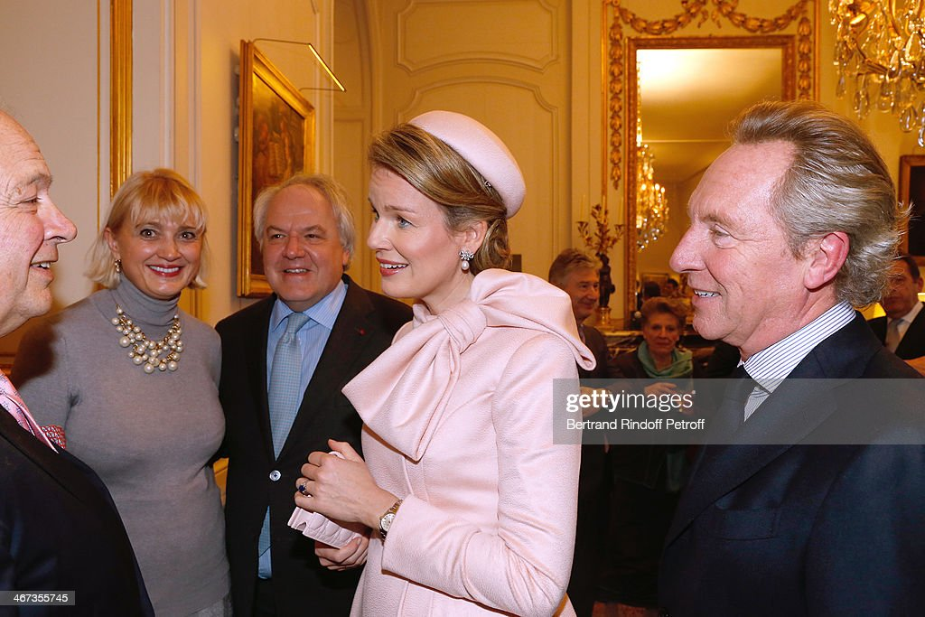 Guest, Carine Jacquot Billet and CEO Moet Hennessy Christophe Navarre, Queen Mathilde Of Belgium and Belgian fashion designer Edouard Vermeulen attend the King Philippe of Belgium and Queen Mathilde Of Belgium visit the Residence of the Ambassador of Belgium whyle a One Day Official Visit in Paris on February 6, 2014. Paris, France.