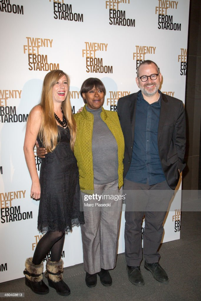 A guest, Claudia Lennear and director Morgan Neville attend the 'Twenty feet from stardom' Paris premiere at Cinema UGC Normandie on November 18, 2013 in Paris, France.