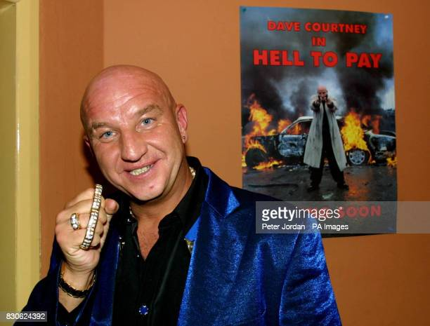 Guest Dave Courtney shows off a knuckle duster at the Manhattan Cafe in Woolwich south east London the venue for a reception after the marriage of...