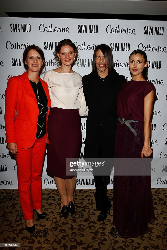 A guest, designer Inna Thomas, Jorge Gonzalez and Fiona Erdmann pose at the Sava Nald show during the Mercedes-Benz Fashion Week Autumn/Winter 2014/15 at Hotel Adlon on January 14, 2014 in Berlin, Germany.