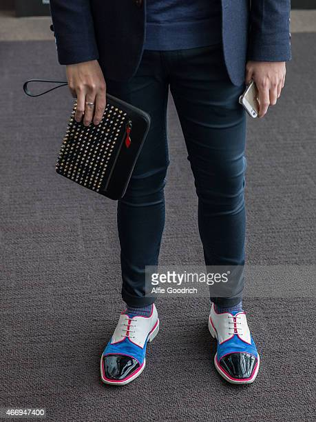 A guest detail is seen wearing jacket by Initial of Hong Kong trousers by Top Man shoes and clutch by Christian Louboutin during the Mercedes Benz...