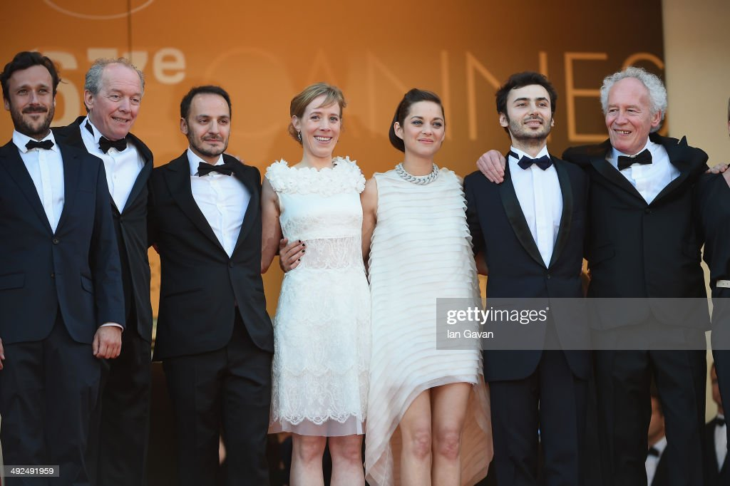 A guest, director <a gi-track='captionPersonalityLinkClicked' href=/galleries/search?phrase=Luc+Dardenne&family=editorial&specificpeople=215507 ng-click='$event.stopPropagation()'>Luc Dardenne</a>, actors Fabrizio Rongione, Christelle Cornil, <a gi-track='captionPersonalityLinkClicked' href=/galleries/search?phrase=Marion+Cotillard&family=editorial&specificpeople=215303 ng-click='$event.stopPropagation()'>Marion Cotillard</a>, a guest and director <a gi-track='captionPersonalityLinkClicked' href=/galleries/search?phrase=Jean-Pierre+Dardenne&family=editorial&specificpeople=606914 ng-click='$event.stopPropagation()'>Jean-Pierre Dardenne</a> attend the 'Two Days, One Night' (Deux Jours, Une Nuit) premiere during the 67th Annual Cannes Film Festival on May 20, 2014 in Cannes, France.