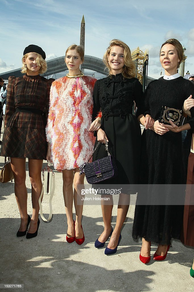 Guest, Elena Perminova, <a gi-track='captionPersonalityLinkClicked' href=/galleries/search?phrase=Natalia+Vodianova&family=editorial&specificpeople=203265 ng-click='$event.stopPropagation()'>Natalia Vodianova</a> and Ulyana Sergeenko attend the Valentino Spring / Summer 2013 show as part of Paris Fashion Week at Espace Ephemere Tuileries on October 2, 2012 in Paris, France.