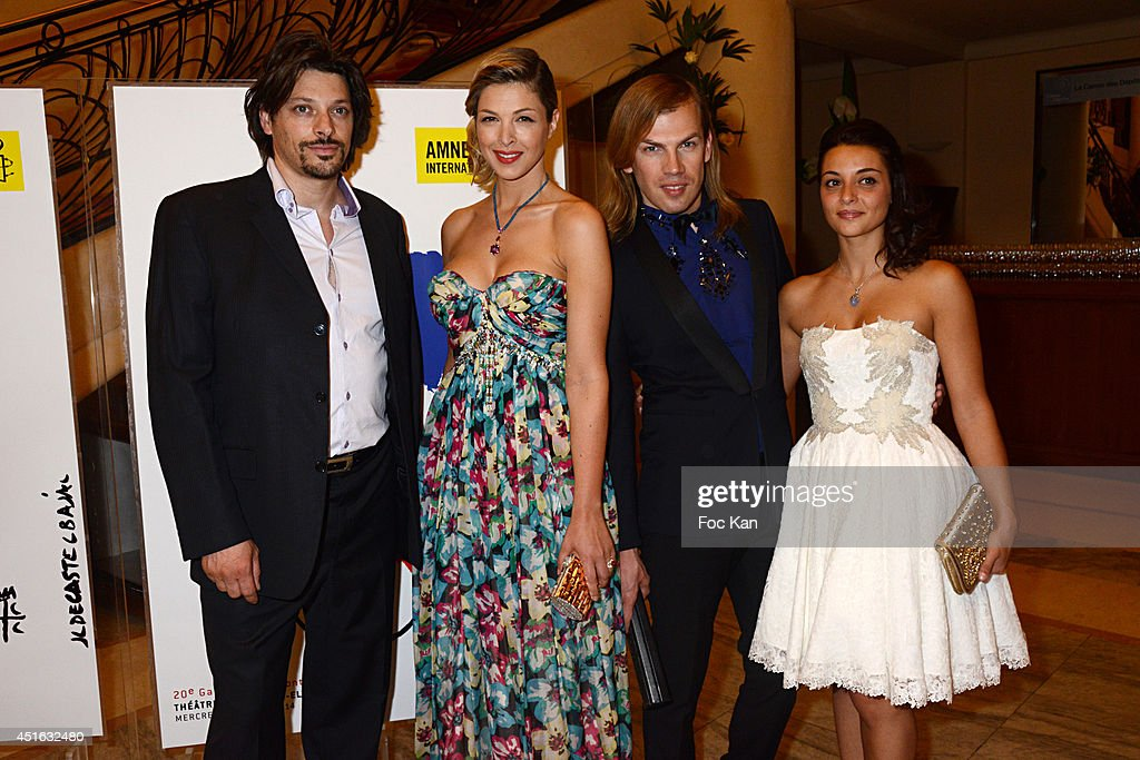 A guest, Eleonore Boccara, <a gi-track='captionPersonalityLinkClicked' href=/galleries/search?phrase=Christophe+Guillarme&family=editorial&specificpeople=9441846 ng-click='$event.stopPropagation()'>Christophe Guillarme</a> and <a gi-track='captionPersonalityLinkClicked' href=/galleries/search?phrase=Priscilla+Betti&family=editorial&specificpeople=10616880 ng-click='$event.stopPropagation()'>Priscilla Betti</a> attend the '20th Amnesty International France' : Gala At Theatre Des champs Elysees on July 2, 2014 in Paris, France.